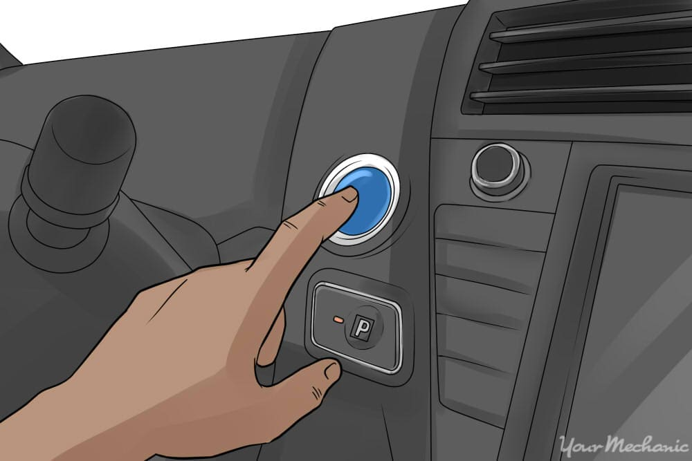 person pressing the engine start/stop button