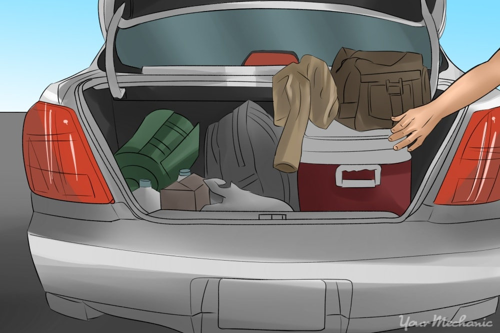 car trunk with cooler and clothes