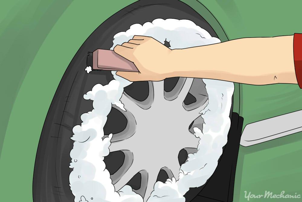 spraying foam on carwheel