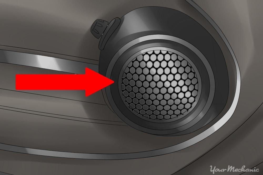 grille covering speaker on side of door