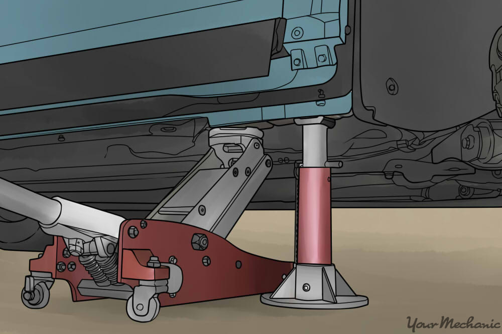 hydraulic jack and jack stand holding up a vehicle