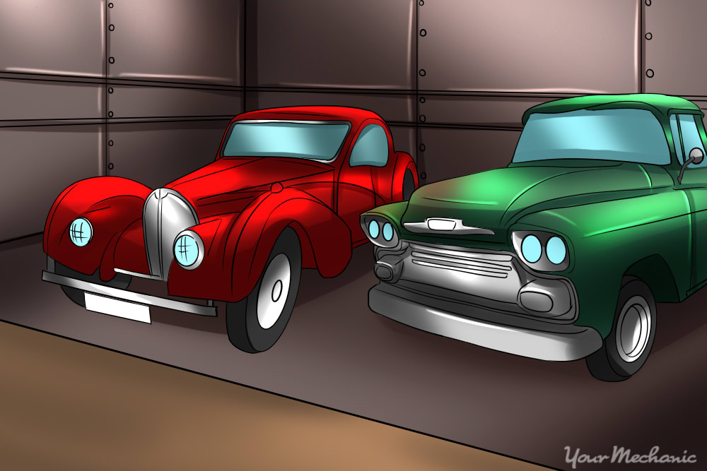 classic cars sitting in an old garage