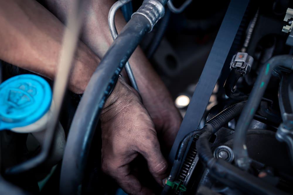 close up of hands installing belt