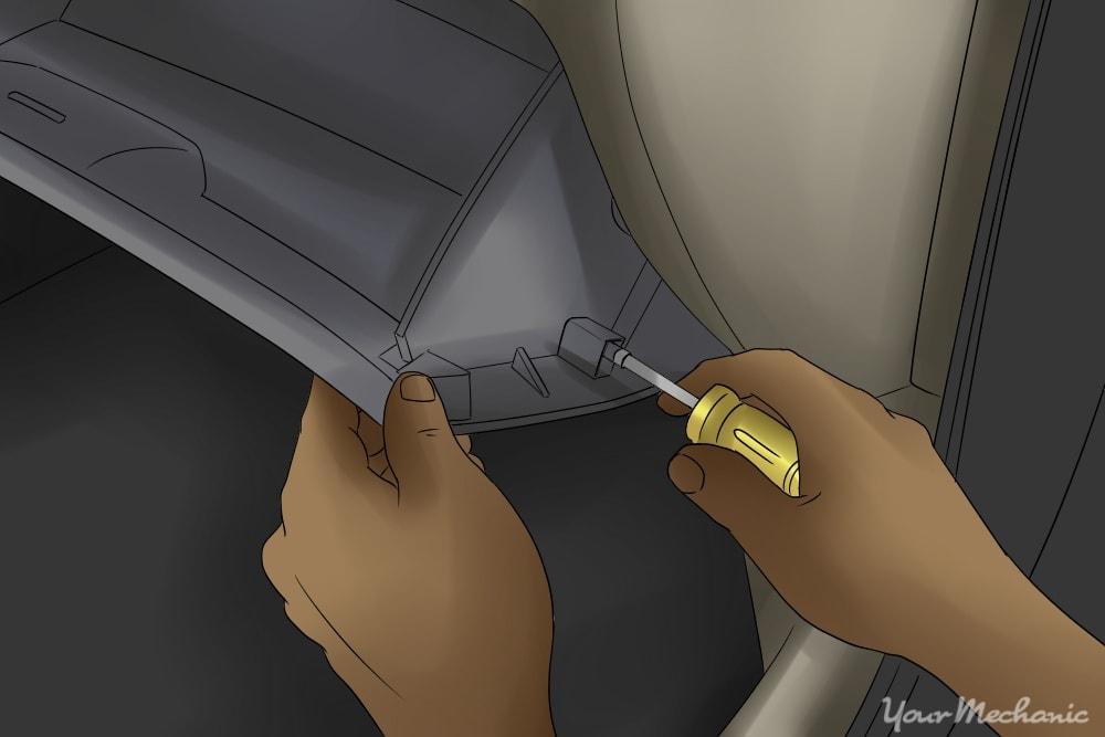 person removing glove box screws