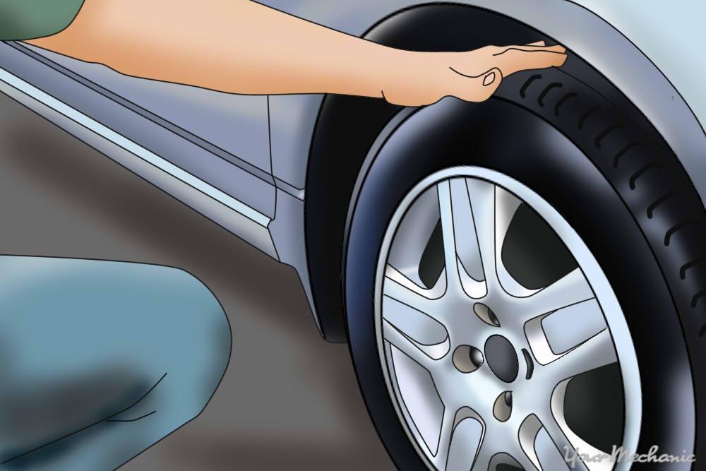 person inspecting car tire