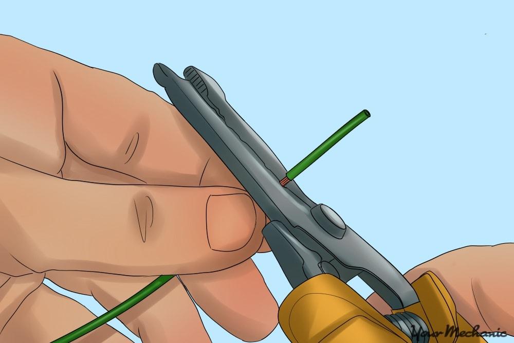 hand using a stripper wire