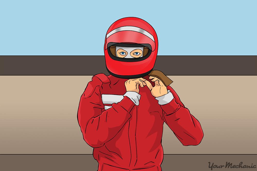 person fastening their helmet on