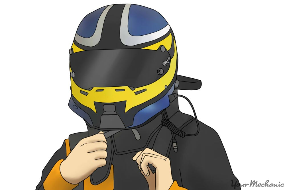 close up of person putting on a racing helmet