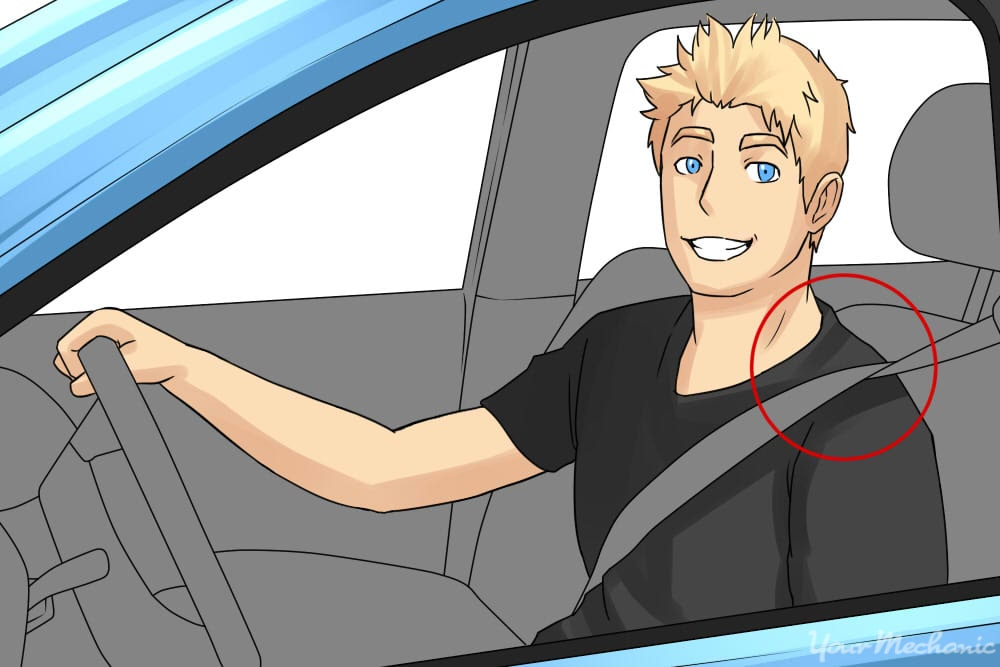 young man with drivers seat belt crossing over around shoulder