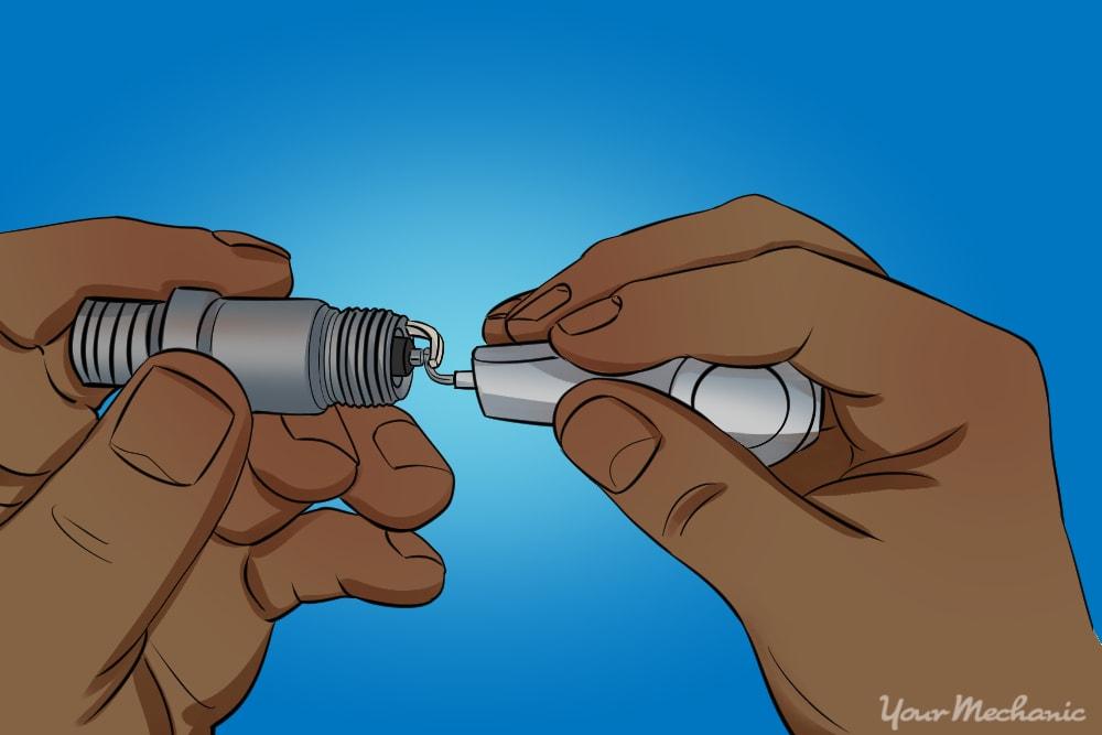 measuring spark plug gap
