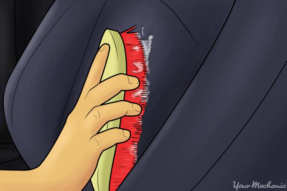 person brushing car seat