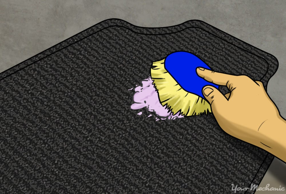 person scrubbing dirty mat