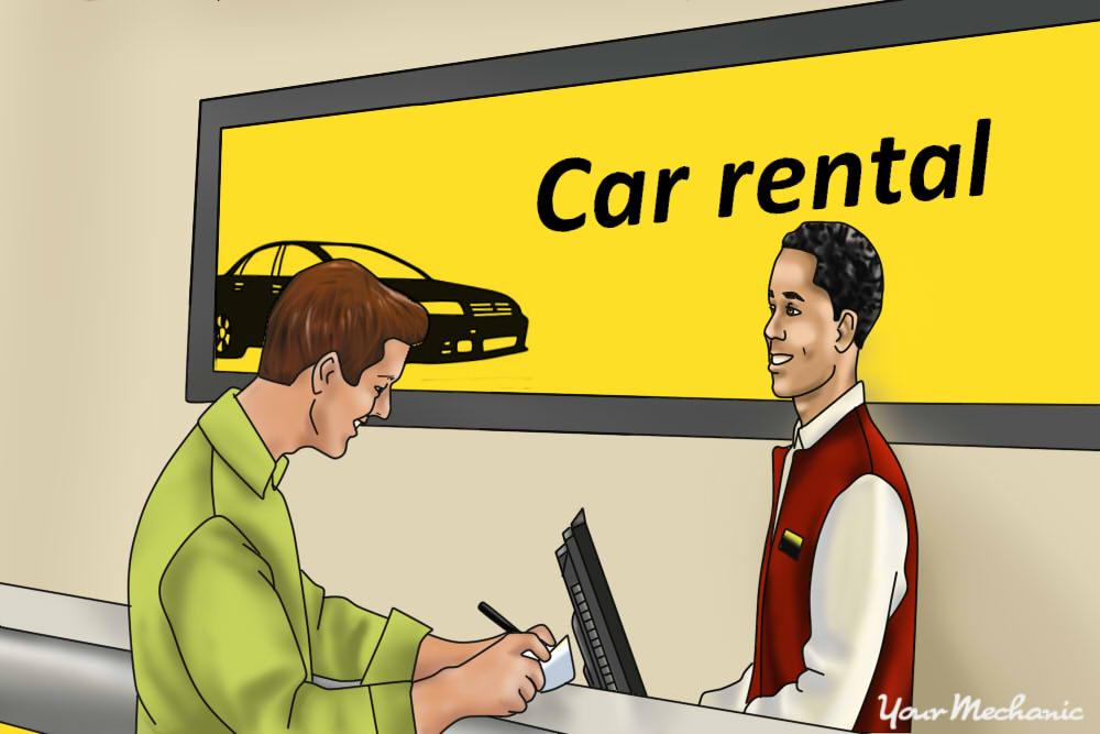 man signing a rental car contract