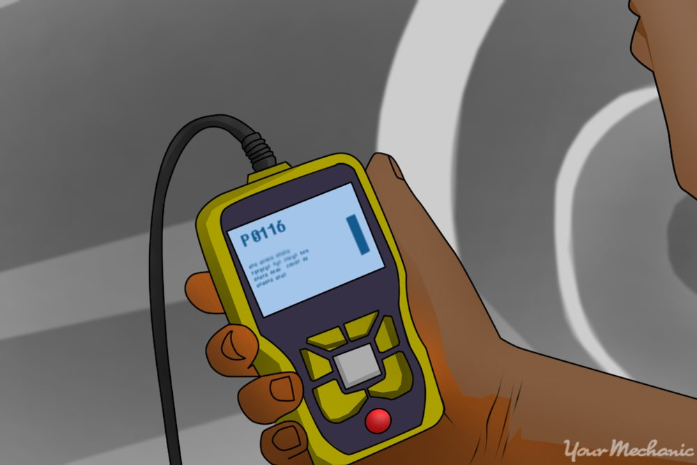 person holding an obd scanner