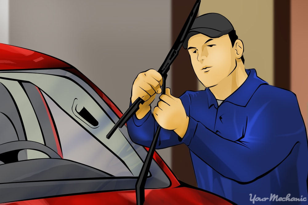 man lifting wipers from windshield