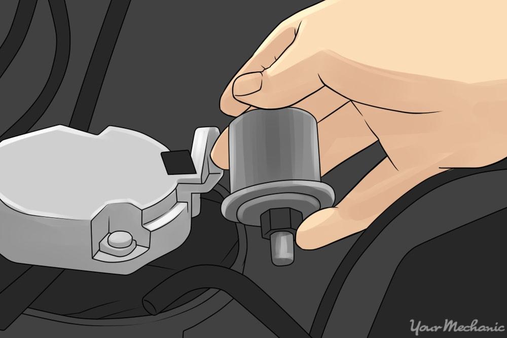 mechanic unplugging oil pressure sensor