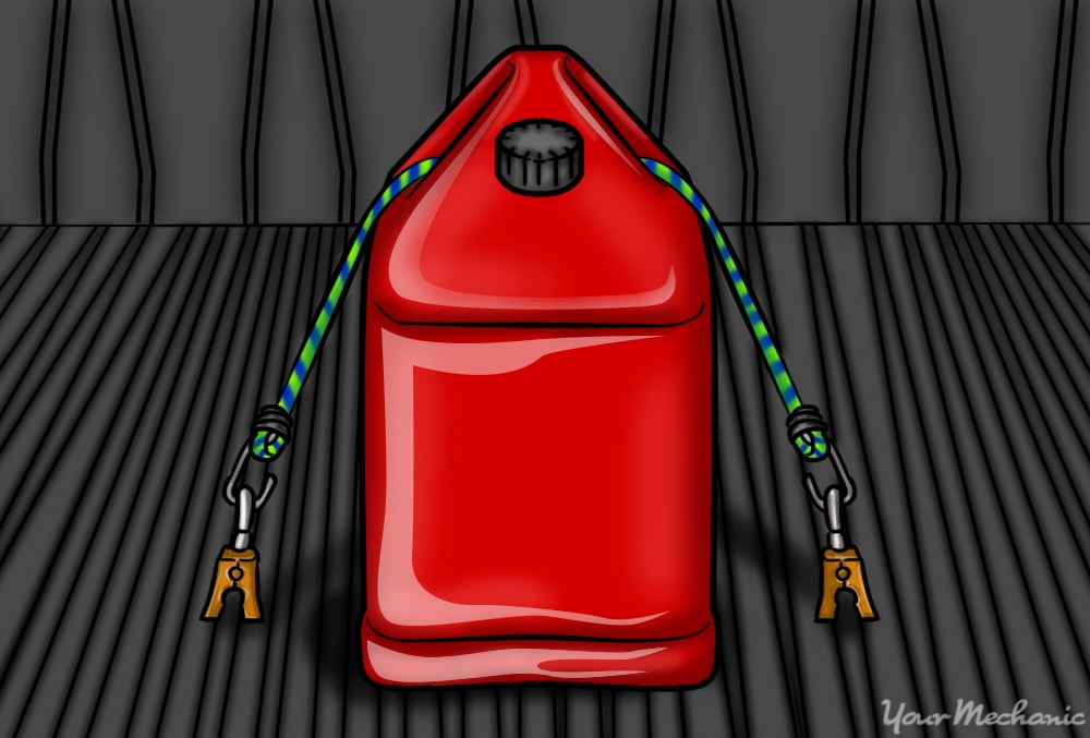 red fuel can securing it to trunk