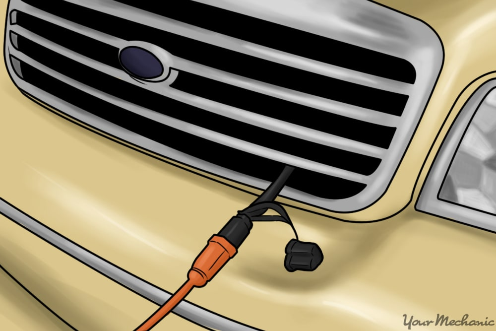 block heater plug extending out of front of truck