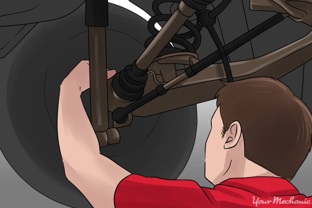 person conducting inspection of underside of engine