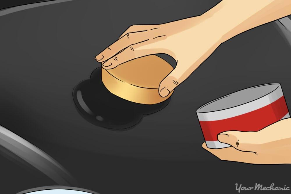 hand polishing car hood