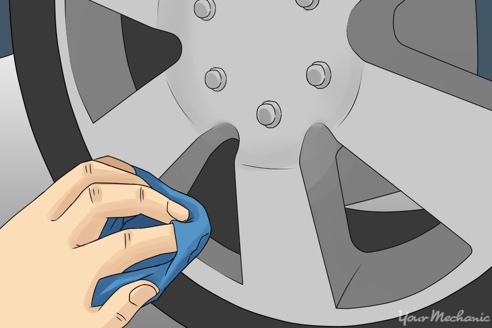wiping polish into wheel