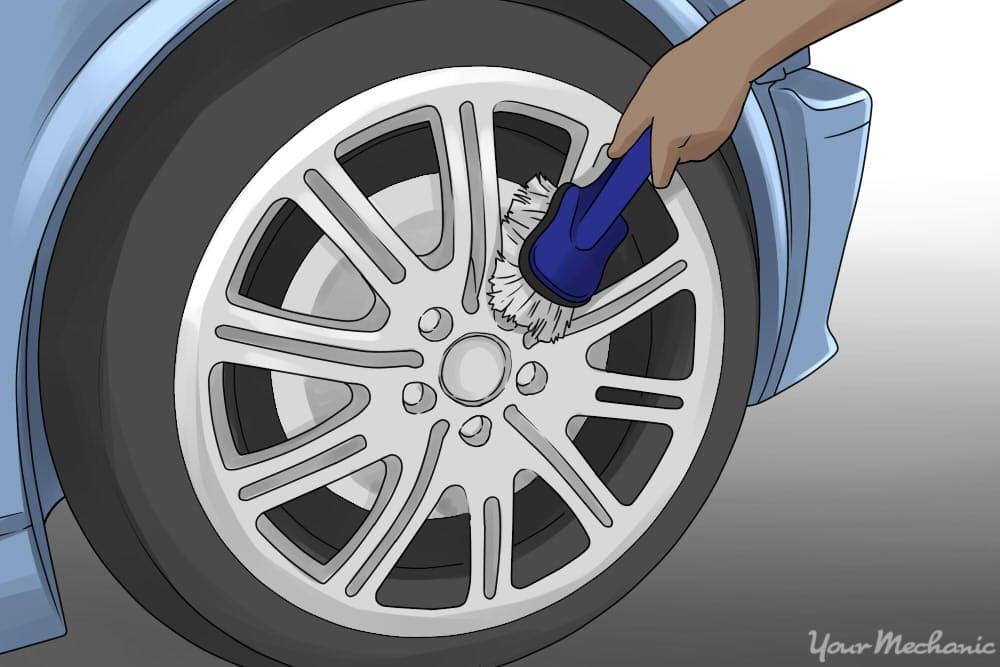 person scrubbing between wheel spokes