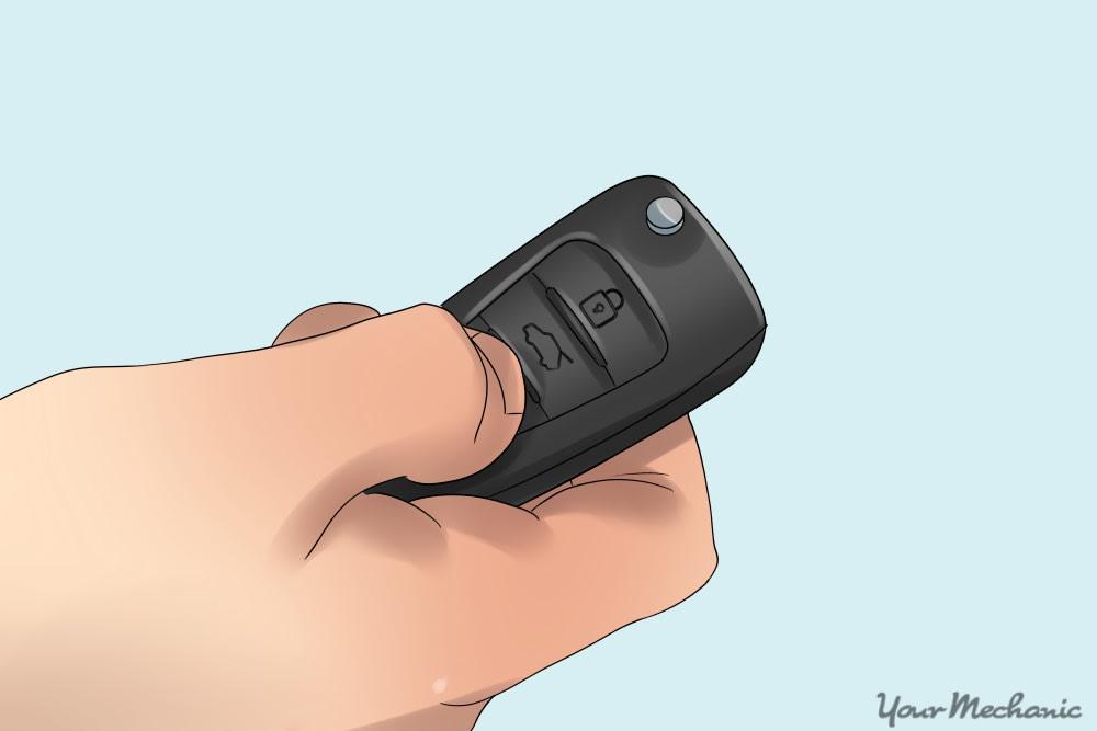 hand pressing car panic button