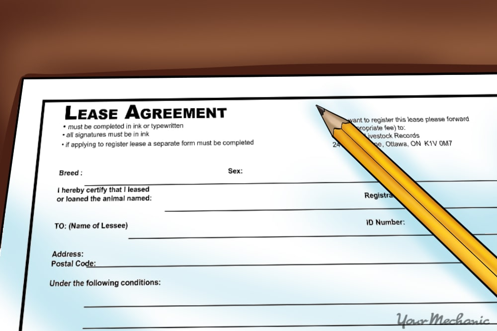 example of paperwork for a car lease with a pencil nearby
