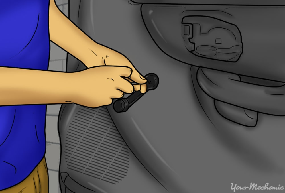 person unscrewing the hand crank on the door panel