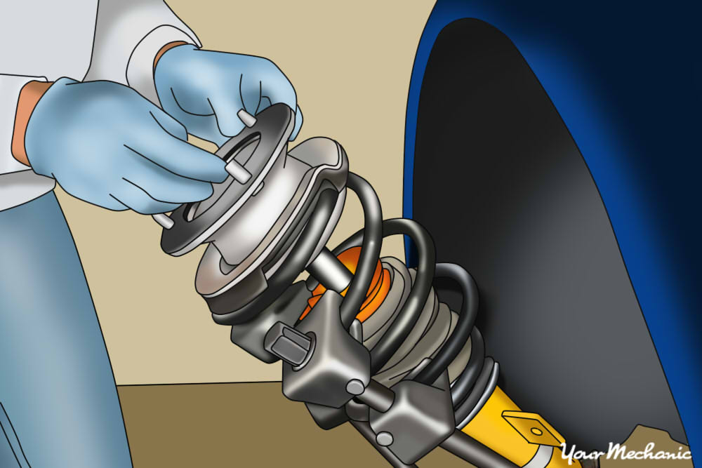 person removing the strut assembly from car