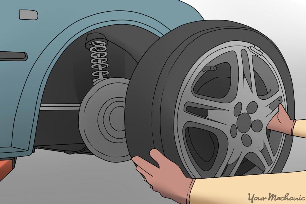person removing car wheel