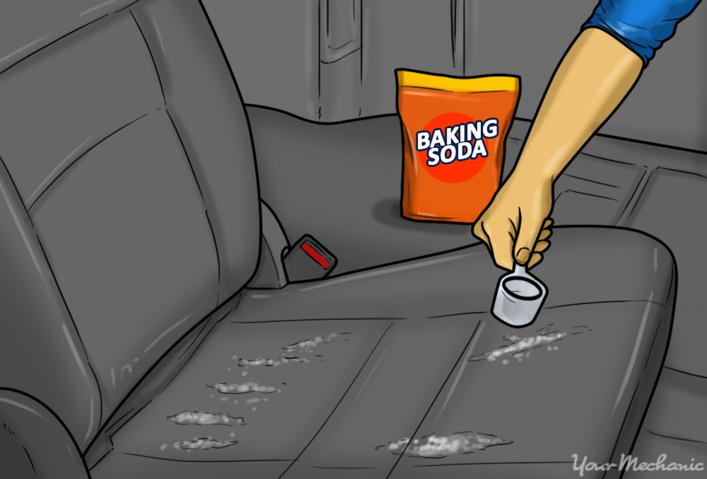 baking soda being applied to a car seat