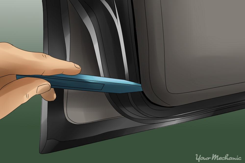 hand prying lightly on edge of door