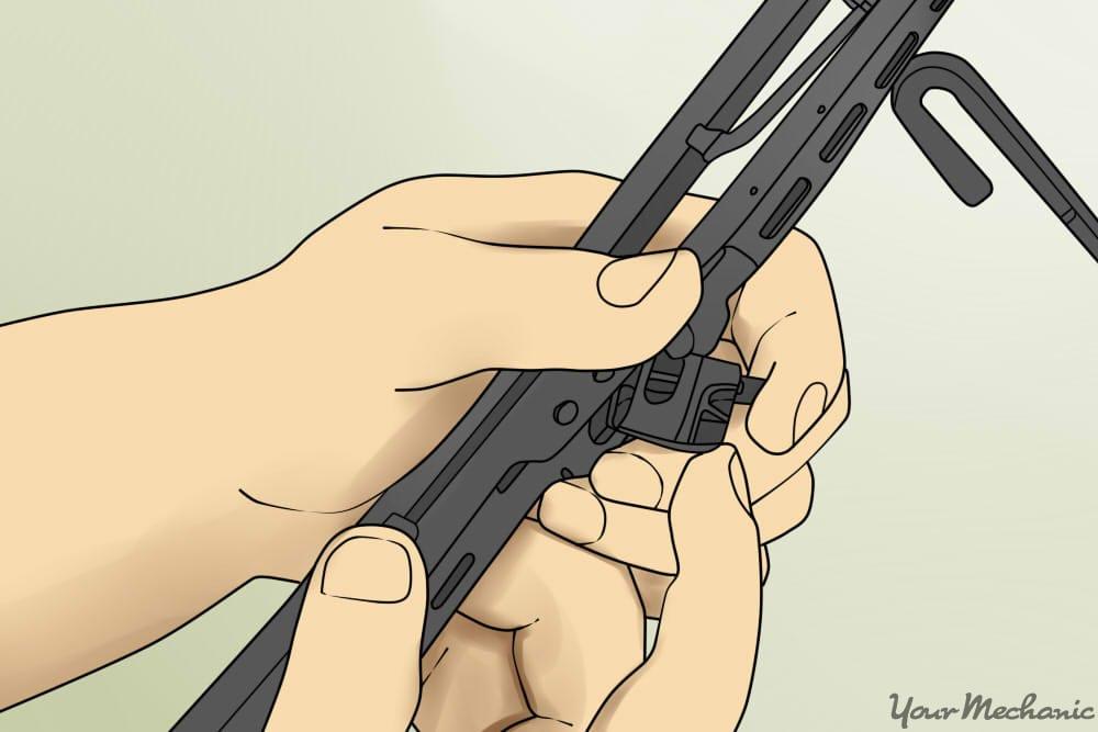 inserting wiper arm into blade