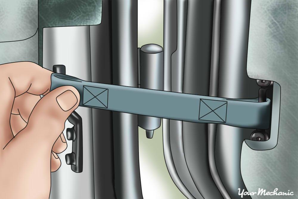 person removing door straps