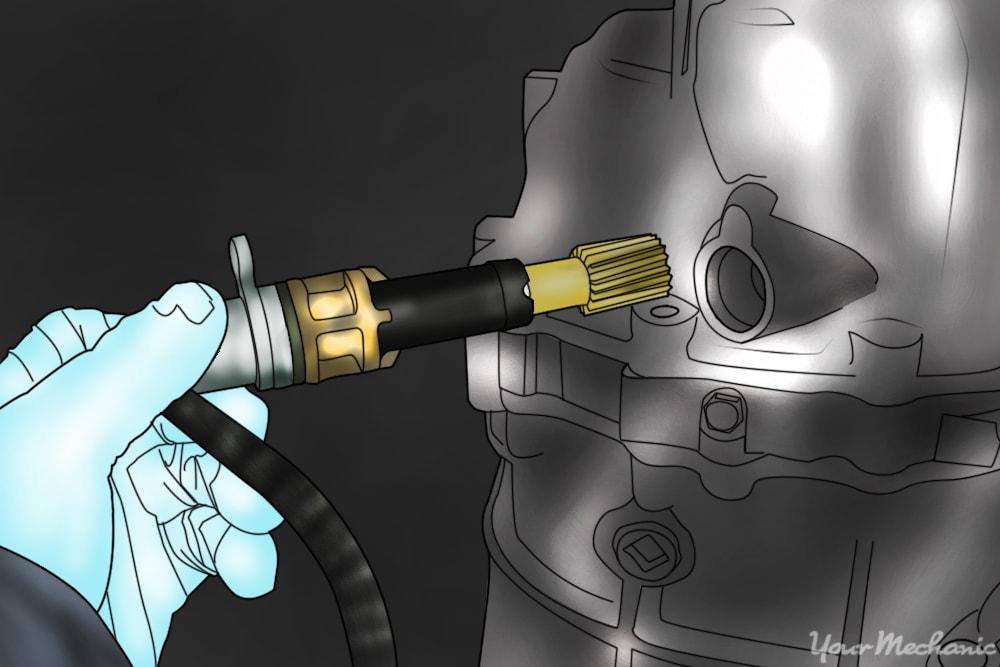 mechanic removing the speedometer sensor
