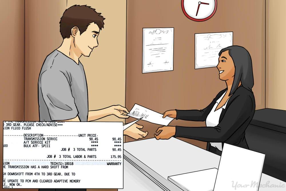 person paying bill at repair shop
