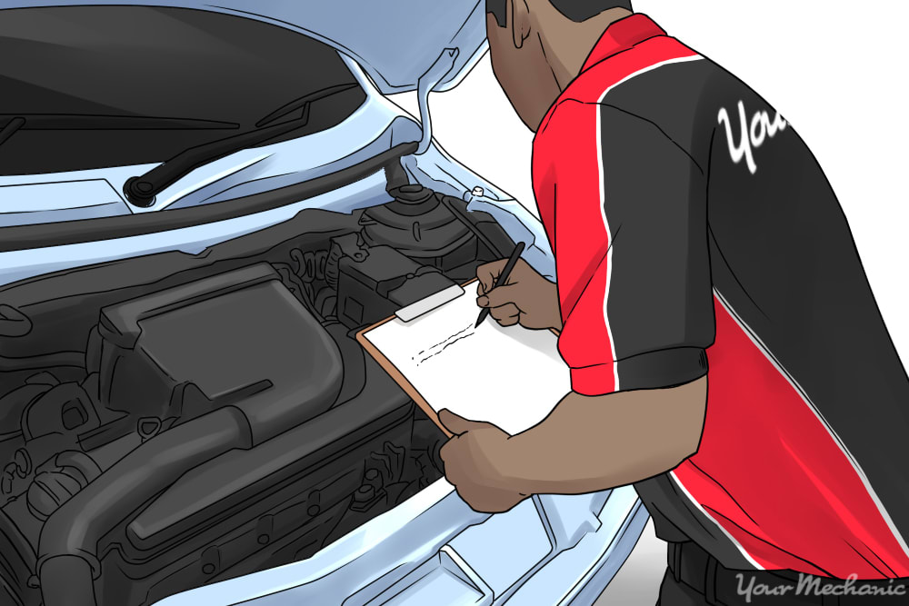 car mechanic with clipboard inspecting the engine