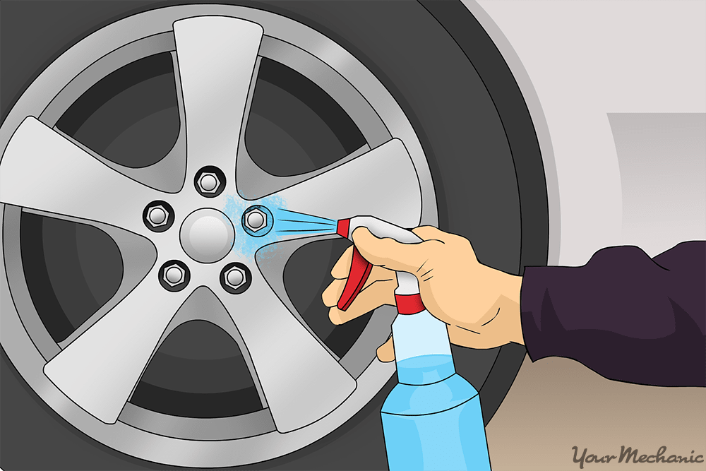 person applying cleaner onto wheel