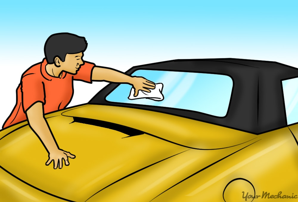 person cleaning of the rear window