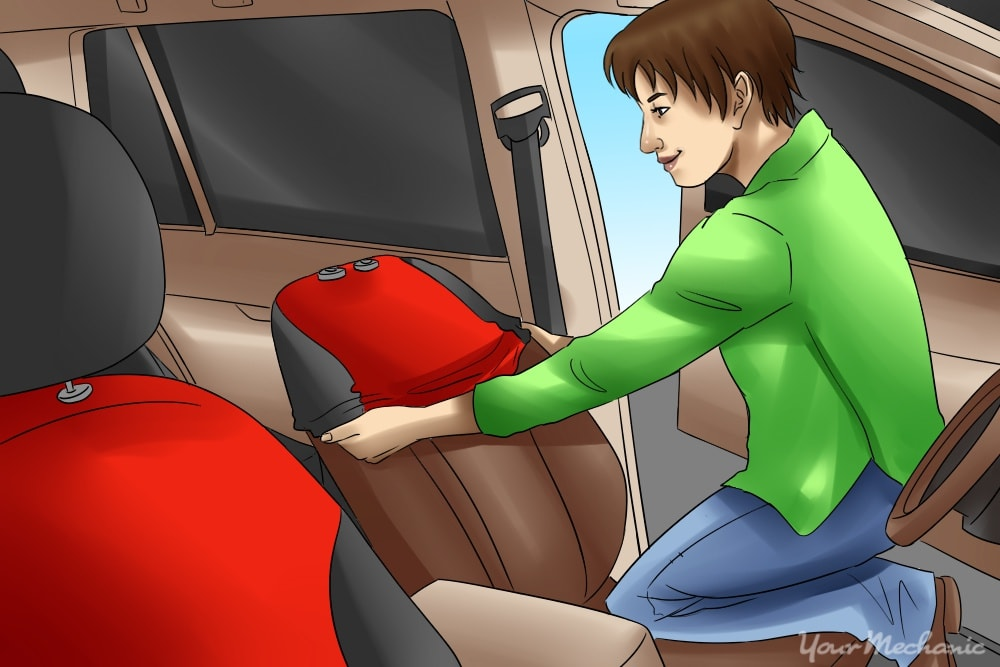 person leaning in to install seat covers
