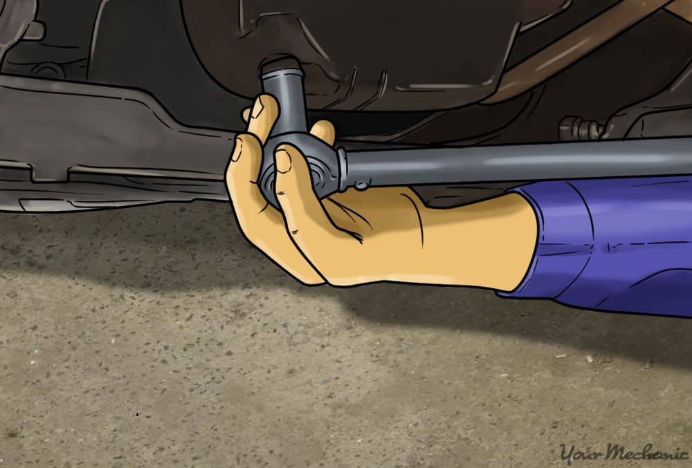 close up of a hand holding a socket wrench attached to a part