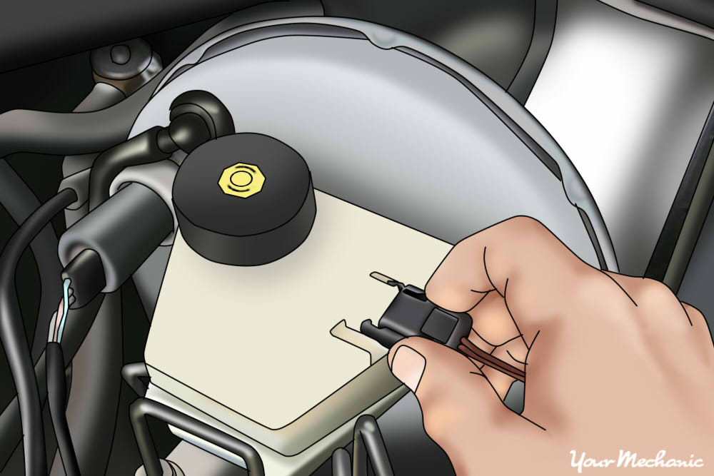 mechanic plugging electrical connector back into the brake pressure switch