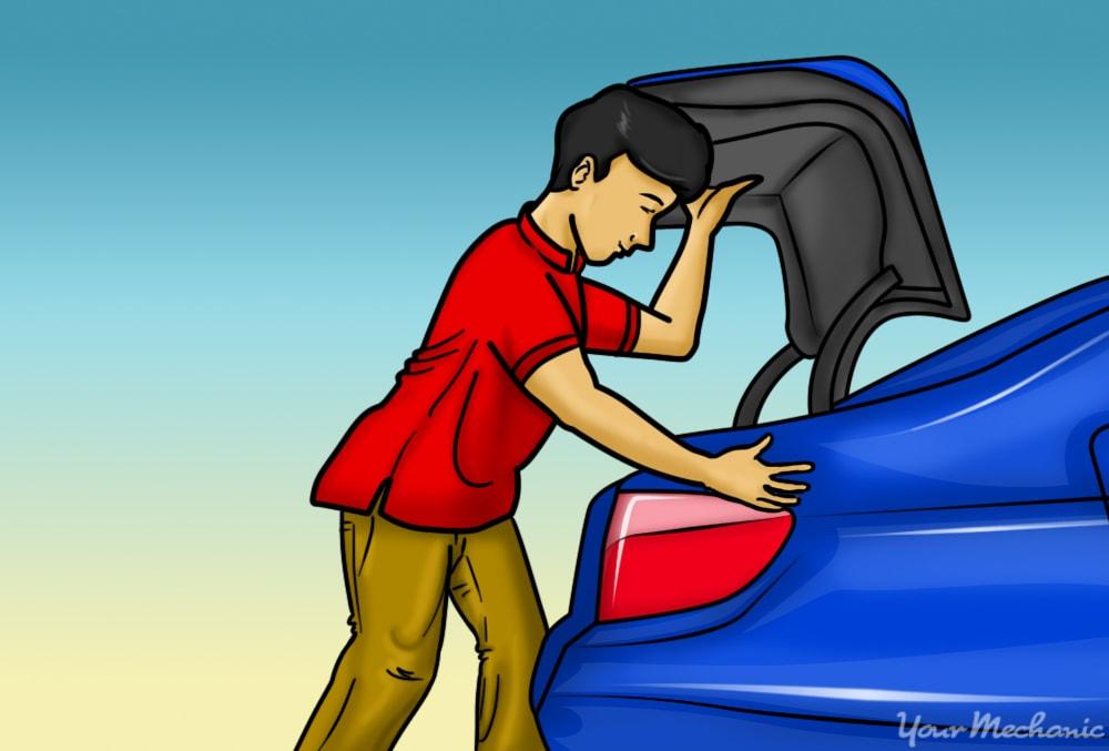 person standing beside open trunk