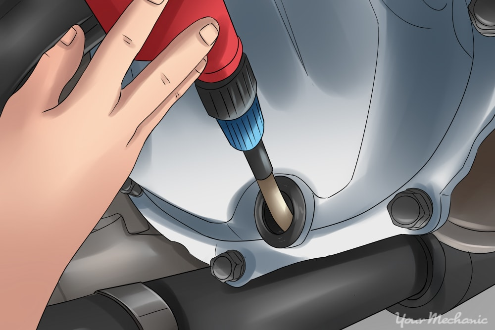 hand adding additional differential fluid
