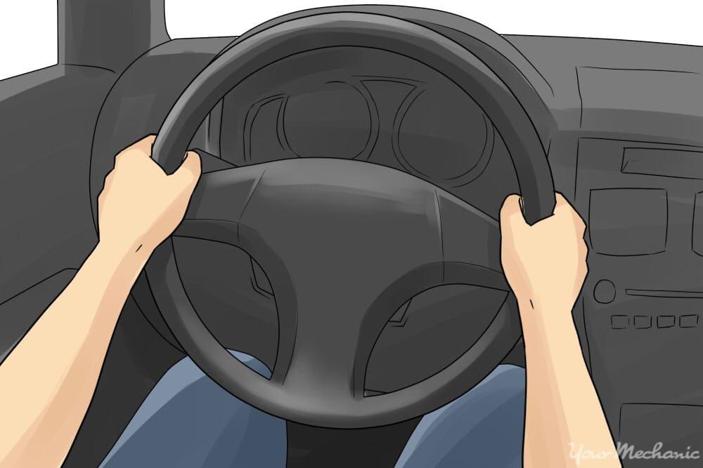 hands in 9-3 position on steering wheel