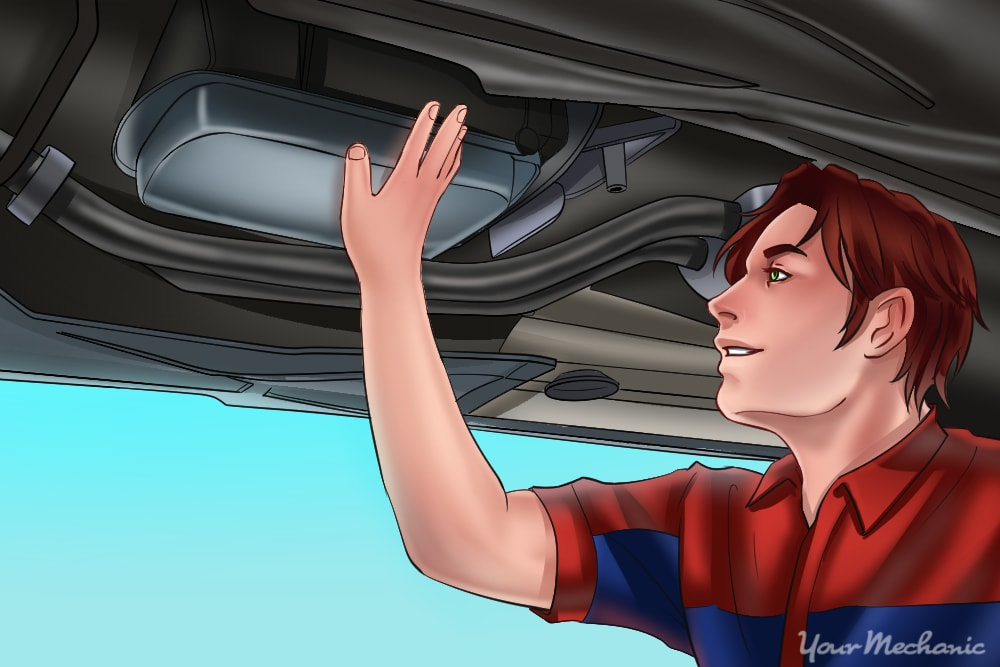 mechanic checking transmission fluid and filter