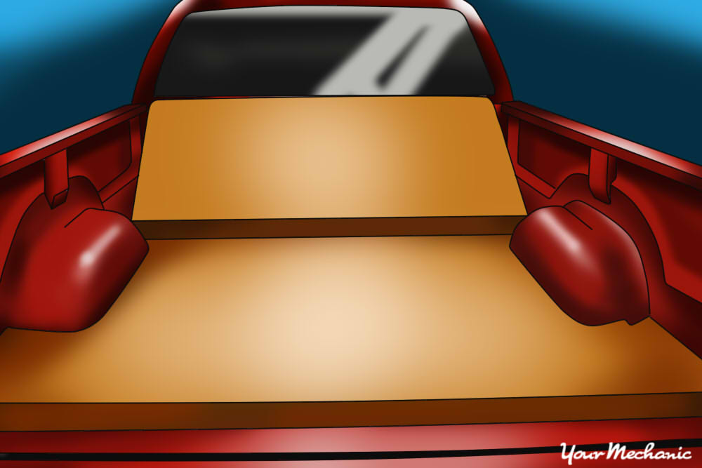 couch placed down in truck bed