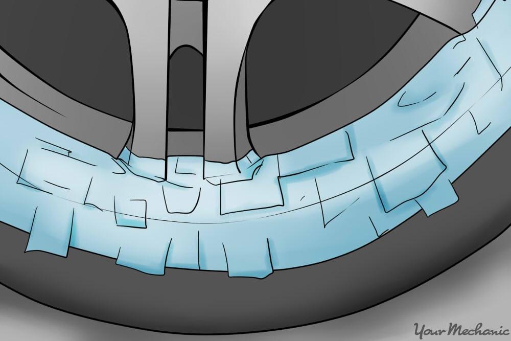 applying masking tape to rim