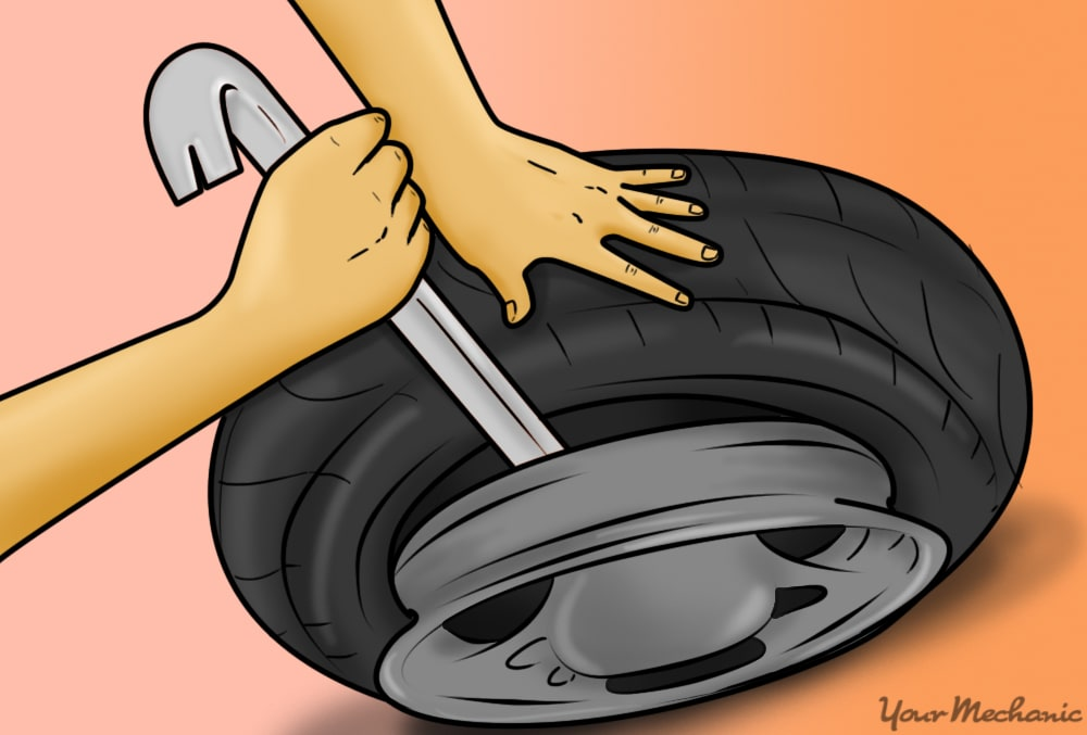 person prying tire bead